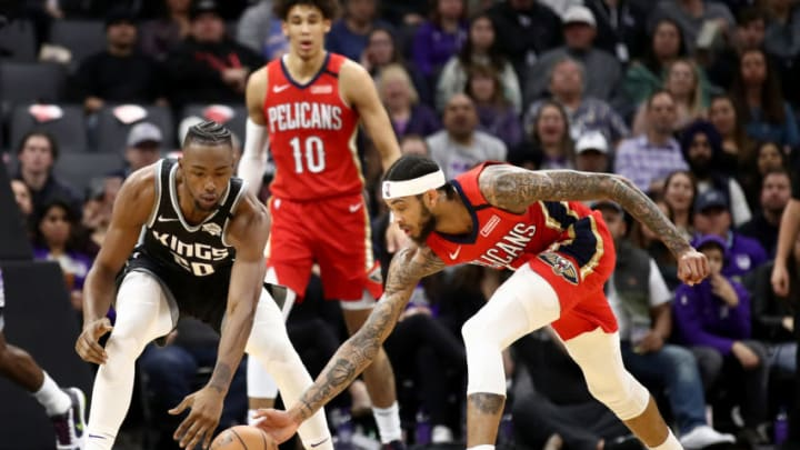 SACRAMENTO, CALIFORNIA - JANUARY 04: Harry Giles III #20 of the Sacramento Kings and Brandon Ingram #14 of the New Orleans Pelicans go for a loose ball at Golden 1 Center on January 04, 2020 in Sacramento, California. NOTE TO USER: User expressly acknowledges and agrees that, by downloading and/or using this photograph, user is consenting to the terms and conditions of the Getty Images License Agreement. (Photo by Ezra Shaw/Getty Images)