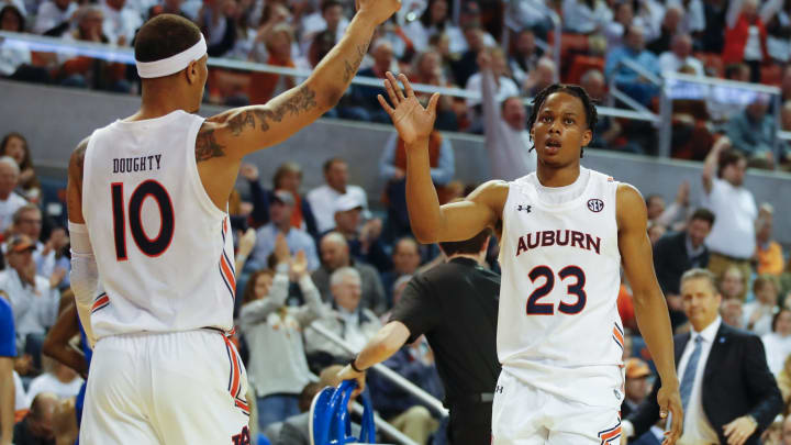 AUBURN, AL – FEBRUARY 01: NBA Draft prospect Isaac Okoro #23 reacts with Samir Doughty #10 of the Auburn Tigers against the Kentucky Wildcats at Auburn Arena. (Photo by Todd Kirkland/Getty Images)
