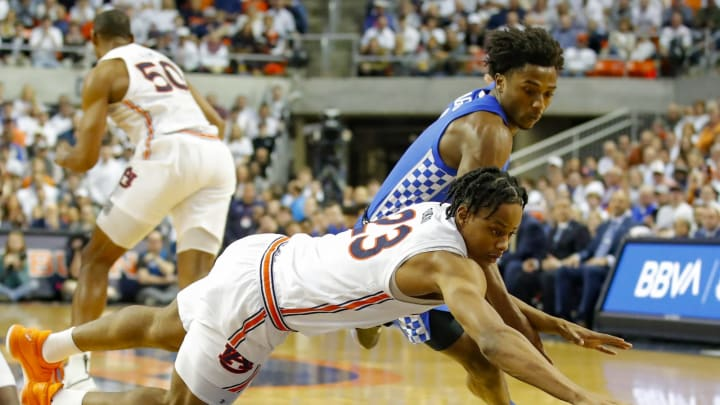 AUBURN, AL – FEBRUARY 01: Isaac Okoro #23 of the Auburn Tigers battles Ashton Hagans #0 of the Kentucky Wildcats and recovers the ball during the first half of the game at Auburn Arena (Photo by Todd Kirkland/Getty Images)