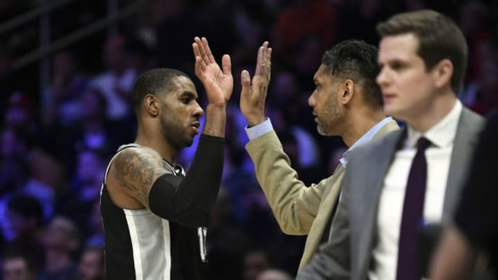 LOS ANGELES, CA - FEBRUARY 03: LaMarcus Aldridge #12 of the San Antonio Spurs high fives with assistant coach Tim Duncan after scoring a basket against Los Angeles Clippers (Photo by Kevork Djansezian/Getty Images)