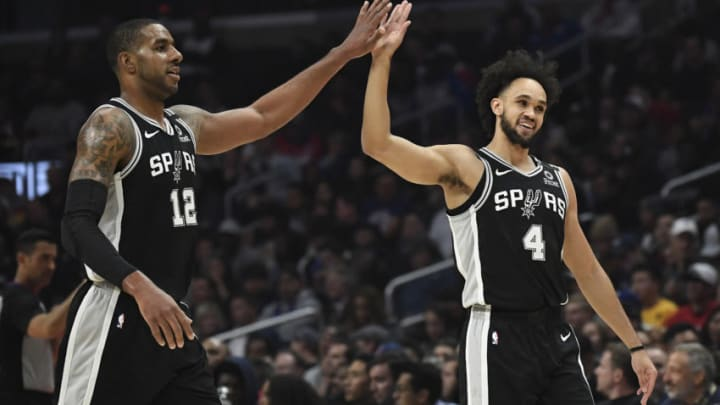 LOS ANGELES, CA - FEBRUARY 03: LaMarcus Aldridge #12 of the San Antonio Spurs is congratulated by Derrick White #4 after scoring a basket against Los Angeles Clippers at Staples Center (Photo by Kevork Djansezian/Getty Images)
