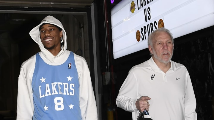 LOS ANGELES, CA – FEBRUARY 04: DeMar DeRozan #10 of the San Antonio Spurs arrives with head coach Gregg Popovich wearing a Kobe Bryant jersey in honor of the late Lakers great (Photo by Kevork Djansezian/Getty Images)