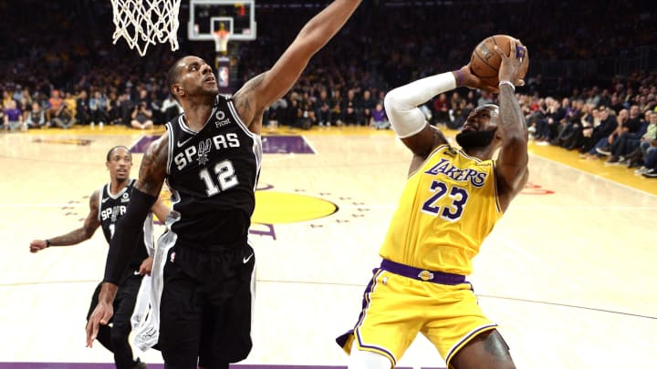 LOS ANGELES, CA – FEBRUARY 04: LeBron James #23 of the Los Angeles Lakers goes for a layup against LaMarcus Aldridge #12 of the San Antonio Spurs during the game at Staples Center (Photo by Kevork Djansezian/Getty Images)