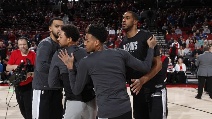 The San Antonio Spurs huddle up. (Photo by Cameron Browne/NBAE via Getty Images)