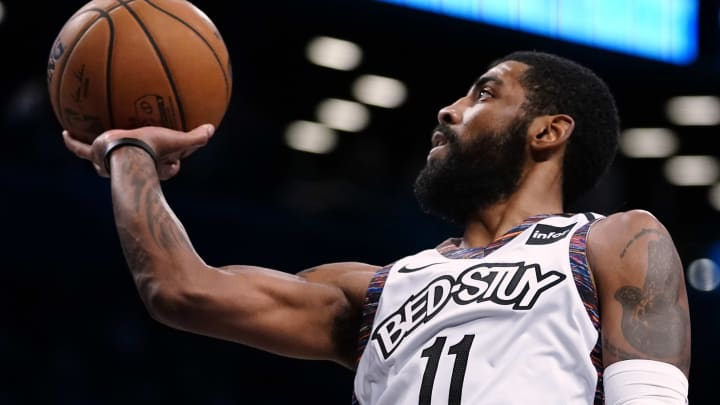 NEW YORK, NY – JANUARY 12: Kyrie Irving #11 of the Brooklyn Nets lays up a shot in an NBA basketball game against the Atlanta Hawks. (Photo by Paul Bereswill/Getty Images)