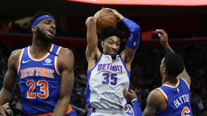 DETROIT, MI – FEBRUARY 8: Christian Wood #35 of the Detroit Pistons grabs a rebound against Mitchell Robinson #23 and Elfrid Payton #6 of the New York Knicks at Little Caesars Arena (Photo by Duane Burleson/Getty Images)