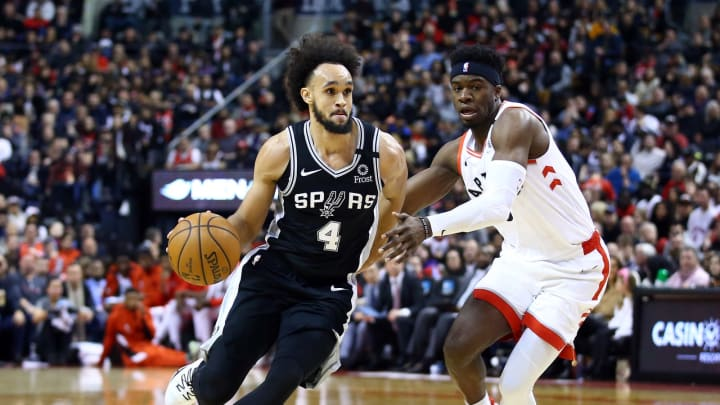 TORONTO, ON – JANUARY 12: Derrick White #4 of the San Antonio Spurs dribbles the ball as Terence Davis II #0 of the Toronto Raptors at Scotiabank Arena on January 12, 2020 (Photo by Vaughn Ridley/Getty Images)