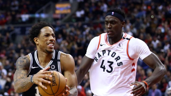 TORONTO, ON – JANUARY 12: DeMar DeRozan #10 of the San Antonio Spurs dribbles the ball as Pascal Siakam #43 of the Toronto Raptors defends during the game at Scotiabank Arena (Photo by Vaughn Ridley/Getty Images)