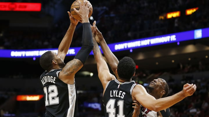 MIAMI, FLORIDA – JANUARY 15: LaMarcus Aldridge #12 and Trey Lyles #41 of the San Antonio Spurs battle for a rebound with Bam Adebayo #13 of the Miami Heat during the first half at American Airlines Arena on January 15, 2020 in Miami, Florida. (Photo by Michael Reaves/Getty Images)