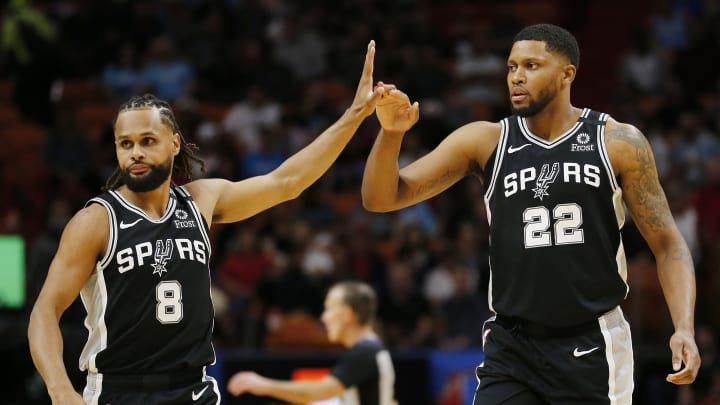 MIAMI, FLORIDA – JANUARY 15: Patty Mills #8 of the San Antonio Spurs celebrates with Rudy Gay #22 against the Miami Heat during the first half at American Airlines Arena. (Photo by Michael Reaves/Getty Images)