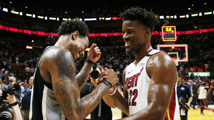 MIAMI, FLORIDA – JANUARY 15: Jimmy Butler #22 of the Miami Heat greets DeMar DeRozan #10 of the San Antonio Spurs after the game at American Airlines Arena on January 15, 2020 in Miami, Florida. (Photo by Michael Reaves/Getty Images)