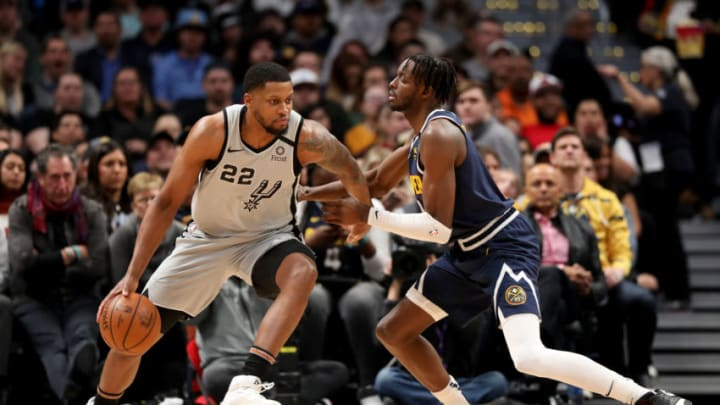 DENVER, CO - FEBRUARY 10: Rudy Gay #22 of the San Antonio Spurs makes a move past Jerami Grant #9 of the Denver Nuggets at Pepsi Center (Photo by Jamie Schwaberow/Getty Images)