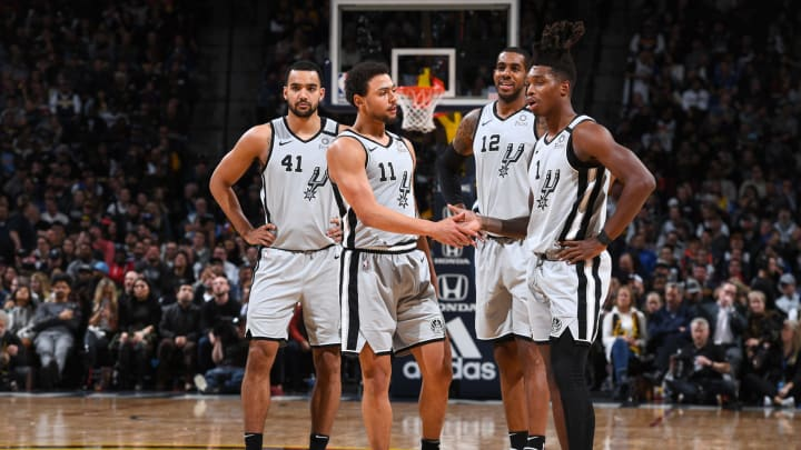Lonnie Walker IV of the San Antonio Spurs1 high-fives Bryn Forbes of the San Antonio Spurs> (Photo by Garrett Ellwood/NBAE via Getty Images)