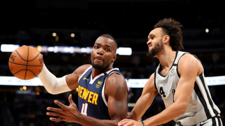 DENVER, CO - FEBRUARY 10: Paul Millsap #4 of the Denver Nuggets and Derrick White #4 of the San Antonio Spurs battle for a loose ball at Pepsi Center. (Photo by Jamie Schwaberow/Getty Images)