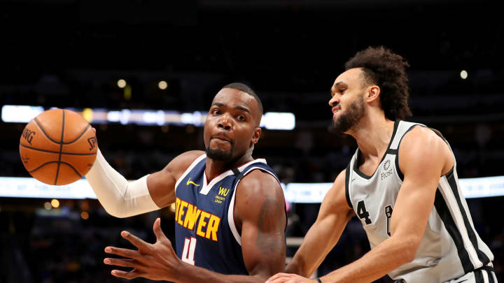 DENVER, CO – FEBRUARY 10: Paul Millsap #4 of the Denver Nuggets and Derrick White #4 of the San Antonio Spurs battle for a loose ball at Pepsi Center. (Photo by Jamie Schwaberow/Getty Images)