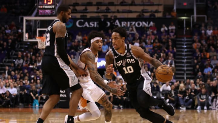 PHOENIX, ARIZONA - JANUARY 20: DeMar DeRozan #10 of the San Antonio Spurs drives the ball past Kelly Oubre Jr. #3 of the Phoenix Suns during the second half of the NBA game at Talking Stick Resort Arena on January 20, 2020 in Phoenix, Arizona. The Spurs defeated the Suns 120-118. NOTE TO USER: User expressly acknowledges and agrees that, by downloading and or using this photograph, user is consenting to the terms and conditions of the Getty Images License Agreement. (Photo by Christian Petersen/Getty Images)