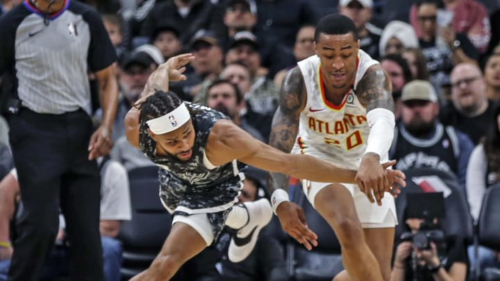SAN ANTONIO, TX – JANUARY 17: Patty Mills #8 of the San Antonio Spurs tries for a steal on John Collins #20 of the Atlanta Hawks at AT&T Center on January 17, 2020, in San Antonio, Texas. (Photo by Ronald Cortes/Getty Images)