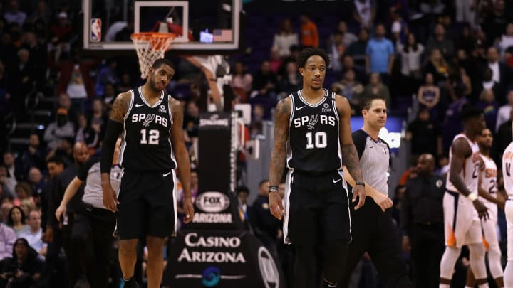PHOENIX, ARIZONA – JANUARY 20: DeMar DeRozan #10 and LaMarcus Aldridge #12 of the San Antonio Spurs walk to the bench during the NBA game against the Phoenix Suns. (Photo by Christian Petersen/Getty Images)