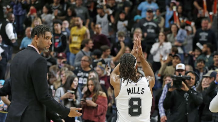 SAN ANTONIO, TX – JANUARY 19: Patty Mills #8 of the San Antonio Spurs applauds fans at the end of game against the Miami Heat as Tim Duncan watches at AT&T Center on January 19, 2020 in San Antonio, Texas. (Photo by Ronald Cortes/Getty Images)