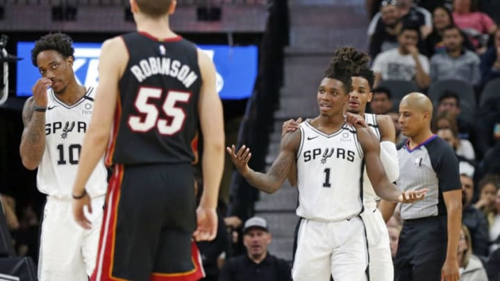 SAN ANTONIO, TX - JANUARY 19: Dejounte Murray #5 of the San Antonio Spurs consoles Lonnie Walker #1 after he was called for a foul during first half action at AT&T Center on January 19, 2020 in San Antonio, Texas. NOTE TO USER: User expressly acknowledges and agrees that , by downloading and or using this photograph, User is consenting to the terms and conditions of the Getty Images License Agreement. (Photo by Ronald Cortes/Getty Images)