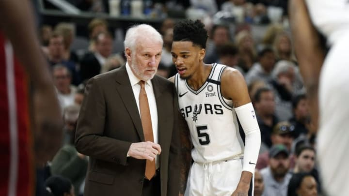 SAN ANTONIO, TX - JANUARY 19: Head coach of the San Antonio Spurs Gregg Popovich talks with Dejounte Murray #5 during first half action at AT&T Center on January 19, 2020 in San Antonio, Texas. NOTE TO USER: User expressly acknowledges and agrees that , by downloading and or using this photograph, User is consenting to the terms and conditions of the Getty Images License Agreement. (Photo by Ronald Cortes/Getty Images)
