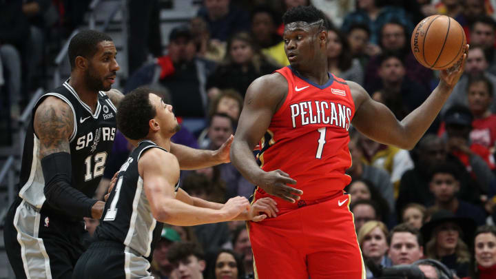 NEW ORLEANS, LOUISIANA – JANUARY 22: Zion Williamson #1 of the New Orleans Pelicans looks to pass the ball over Bryn Forbes #11 of the San Antonio Spurs at Smoothie King Center (Photo by Chris Graythen/Getty Images)