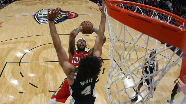 NEW ORLEANS, LOUISIANA – JANUARY 22: Brandon Ingram #14 of the New Orleans Pelicans shoots the ball over Derrick White #4 of the San Antonio Spurs at Smoothie King Center (Photo by Chris Graythen/Getty Images)