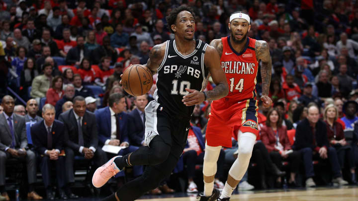 NEW ORLEANS, LOUISIANA – JANUARY 22: DeMar DeRozan #10 of the San Antonio Spurs drives the ball around Brandon Ingram #14 of the New Orleans Pelicans at Smoothie King Center (Photo by Chris Graythen/Getty Images)