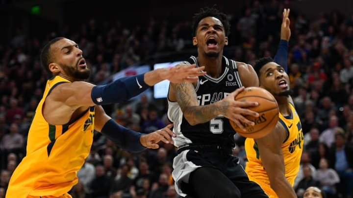 SALT LAKE CITY, UT – FEBRUARY 21: Dejounte Murray #5 of the San Antonio Spurs attempts a shot over Rudy Gobert #27 and Donovan Mitchell #45 of the Utah Jazz at Vivint Smart Home Arena (Photo by Alex Goodlett/Getty Images)
