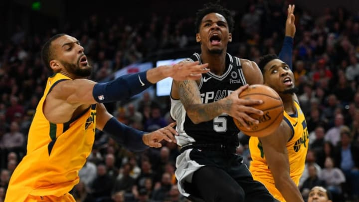 SALT LAKE CITY, UT - FEBRUARY 21: Dejounte Murray #5 of the San Antonio Spurs attempts a shot between Rudy Gobert #27 and Donovan Mitchell #45 of the Utah Jazz during a game at Vivint Smart Home Arena (Photo by Alex Goodlett/Getty Images)