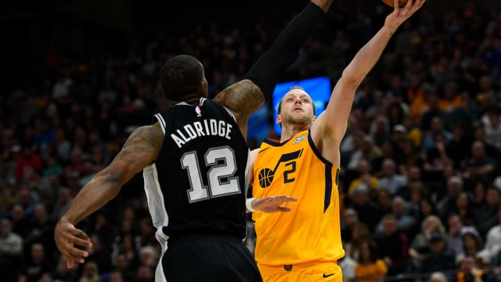 SALT LAKE CITY, UT – FEBRUARY 21: Joe Ingles #2 of the Utah Jazz shoots over LaMarcus Aldridge #12 of the San Antonio Spurs during a game at Vivint Smart Home Arena on February 21, 2020 in Salt Lake City. (Photo by Alex Goodlett/Getty Images)