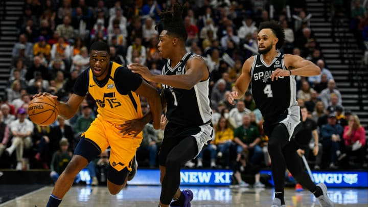 SALT LAKE CITY, UT – FEBRUARY 21: Emmanuel Mudiay #15 of the Utah Jazz drives past Lonnie Walker IV #1 of the San Antonio Spurs during a game at Vivint Smart Home Arena on February 21, 2020 (Photo by Alex Goodlett/Getty Images)
