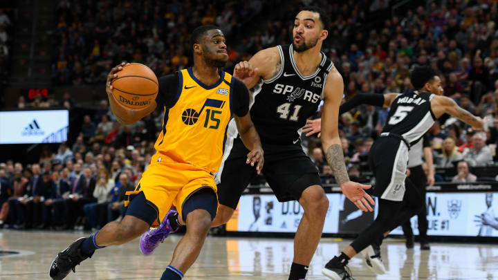 SALT LAKE CITY, UT – FEBRUARY 21: Emmanuel Mudiay #15 of the Utah Jazz drives around Trey Lyles #41 of the San Antonio Spurs during a game at Vivint Smart Home Arena in Salt Lake City, Utah (Photo by Alex Goodlett/Getty Images)