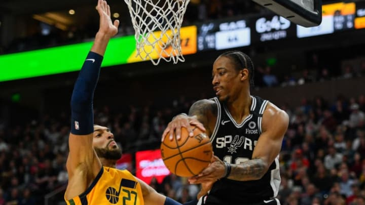 SALT LAKE CITY, UT - FEBRUARY 21: DeMar DeRozan #10 of the San Antonio Spurs attempts to pass around Rudy Gobert #27 of the Utah Jazz during a game at Vivint Smart Home Arena. (Photo by Alex Goodlett/Getty Images)