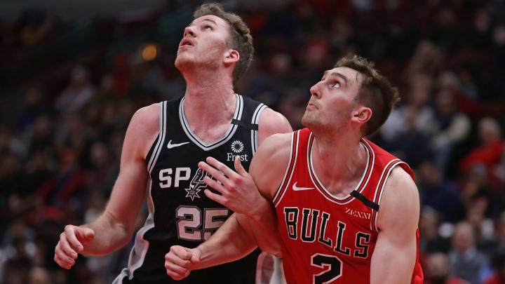 CHICAGO, ILLINOIS – JANUARY 27: Jakob Poeltl #25 of the San Antonio Spurs and Luke Kornet #2 of the Chicago Bulls battle for position during a free throw at the United Center (Photo by Jonathan Daniel/Getty Images)