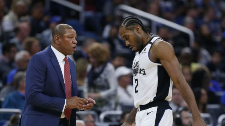 ORLANDO, FLORIDA - JANUARY 26: Head coach Doc Rivers of the LA Clippers talks with Kawhi Leonard #2 against the Orlando Magic. They each spent extended time during their careers with the San Antonio Spurs. (Photo by Michael Reaves/Getty Images)