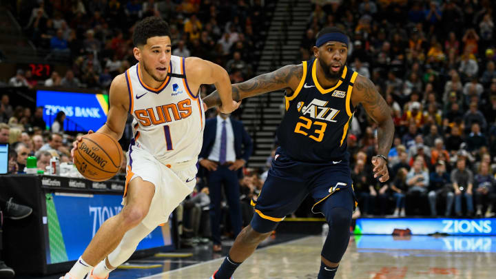 SALT LAKE CITY, UT – FEBRUARY 24: Devin Booker #1 of the Phoenix Suns drives around Royce O'Neale #23 of the Utah Jazz during a game at Vivint Smart Home Arena (Photo by Alex Goodlett/Getty Images)