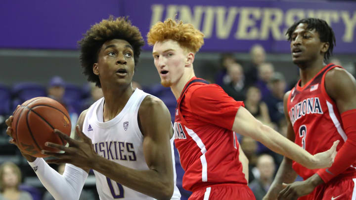 SEATTLE, WASHINGTON – JANUARY 30: Jaden McDaniels #0 of the Washington Huskies works towards the basket against Nico Mannion #1 of the Arizona Wildcats in the first half at Hec Edmundson Pavilion on January 30, 2020 in Seattle, Washington. (Photo by Abbie Parr/Getty Images)