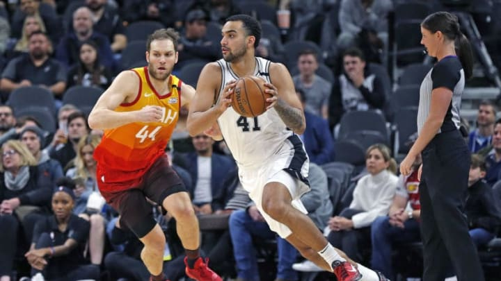 SAN ANTONIO, TX - JANUARY 29: Trey Lyles #41 of the San Antonio Spurs drives on Bojan Bogdanovic #44 of the Utah Jazz during first half action at AT&T Center on January 29, 2020 in San Antonio, Texas. San Antonio Spurs defeated the Utah Jazz 127-120. NOTE TO USER: User expressly acknowledges and agrees that , by downloading and or using this photograph, User is consenting to the terms and conditions of the Getty Images License Agreement. (Photo by Ronald Cortes/Getty Images)