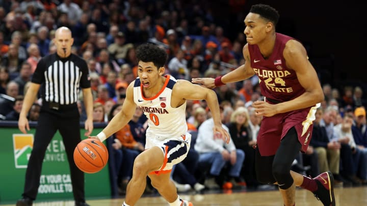 CHARLOTTESVILLE, VA – JANUARY 28: Kihei Clark #0 of the the Virginia Cavaliers drives past Devin Vassell #24 of the the Florida State Seminoles in the second half during a game at John Paul Jones Arena on January 28, 2020 in Charlottesville, Virginia. (Photo by Ryan M. Kelly/Getty Images)