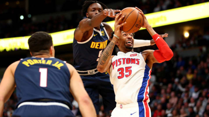 DENVER, CO - FEBRUARY 25: Christian Wood #35 of the Detroit Pistons drives past Jerami Grant #9 of the Denver Nuggets at Pepsi Center on February 25, 2020 (Photo by Jamie Schwaberow/Getty Images)