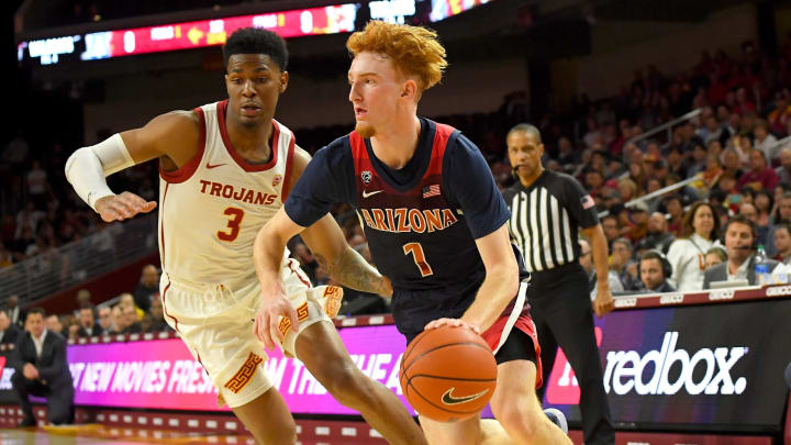 LOS ANGELES, CA – FEBRUARY 27: Elijah Weaver #3 of the USC Trojans guards Nico Mannion #1 of the Arizona Wildcats as he drives to the basket at Galen Center on February 27, 2020. (Photo by Jayne Kamin-Once/Getty Images)