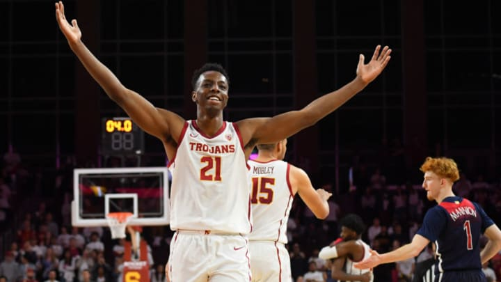 LOS ANGELES, CA - FEBRUARY 27: Onyeka Okongwu #21 of the USC Trojans acknowledges the crowd after defeating the Arizona Wildcats. Okongwu is regarded as an elite center prospect in the 2020 NBA Draft. (Photo by Jayne Kamin-Oncea/Getty Images)