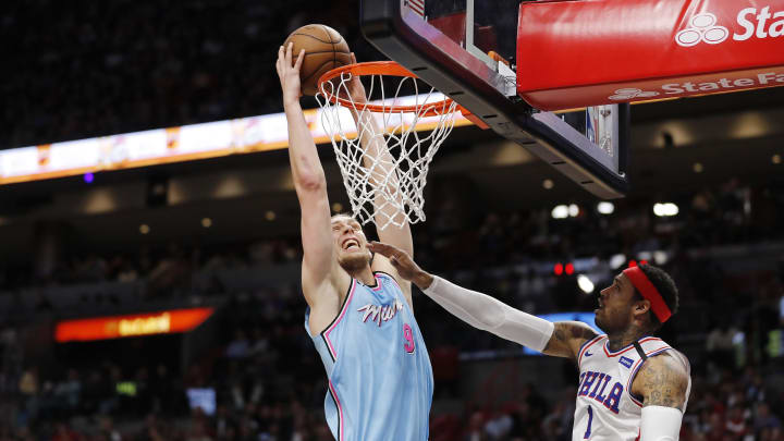 MIAMI, FLORIDA – FEBRUARY 03: Kelly Olynyk #9 of the Miami Heat dunks against the Philadelphia 76ers during the second half at American Airlines Arena (Photo by Michael Reaves/Getty Images)