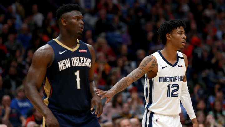 NEW ORLEANS, LOUISIANA – JANUARY 31: Zion Williamson #1 of the New Orleans Pelicans and Ja Morant #12 of the Memphis Grizzlies stand on the court during a game at Smoothie King Center (Photo by Sean Gardner/Getty Images)