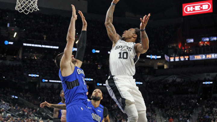 SAN ANTONIO, TX – FEBRUARY 29: DeMar DeRozan #10 of the San Antonio Spurs shoots over Nikola Vucevic #9 of the Orlando Magic during second half action at AT&T Center (Photo by Ronald Cortes/Getty Images)