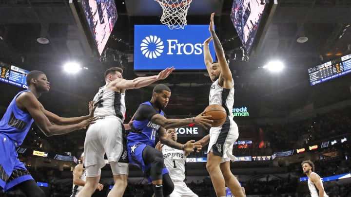 SAN ANTONIO, TX – FEBRUARY 29: D.J. Augustin #14 of the Orlando Magic drives past Drew Eubanks #14nd Trey Lyles #41 of the San Antonio Spurs at AT&T Center (Photo by Ronald Cortes/Getty Images)
