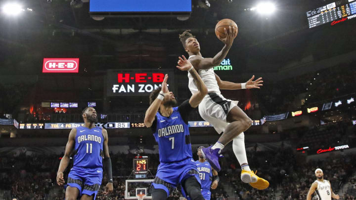 SAN ANTONIO, TX – FEBRUARY 29: Lonnie Walker #1 of the San Antonio Spurs drives past Michael Carter-Williams #7 of the Orlando Magic during second half action at AT&T Center (Photo by Ronald Cortes/Getty Images)