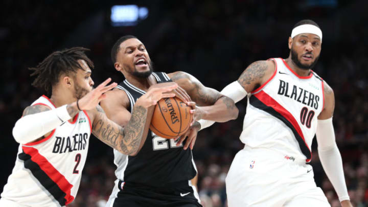 PORTLAND, OREGON - FEBRUARY 06: Rudy Gay #22 of the San Antonio Spurs works towards the basket against Gary Trent Jr. #2 and Carmelo Anthony #00 of the Portland Trail Blazers in the second quarter during their game at Moda Center on February 06, 2020 in Portland, Oregon. NOTE TO USER: User expressly acknowledges and agrees that, by downloading and or using this photograph, User is consenting to the terms and conditions of the Getty Images License Agreement. (Photo by Abbie Parr/Getty Images)