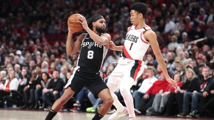 PORTLAND, OREGON – FEBRUARY 06: Patty Mills #8 of the San Antonio Spurs handles the ball against Anfernee Simons #1 of the Portland Trail Blazers in the second quarter at Moda Center (Photo by Abbie Parr/Getty Images)